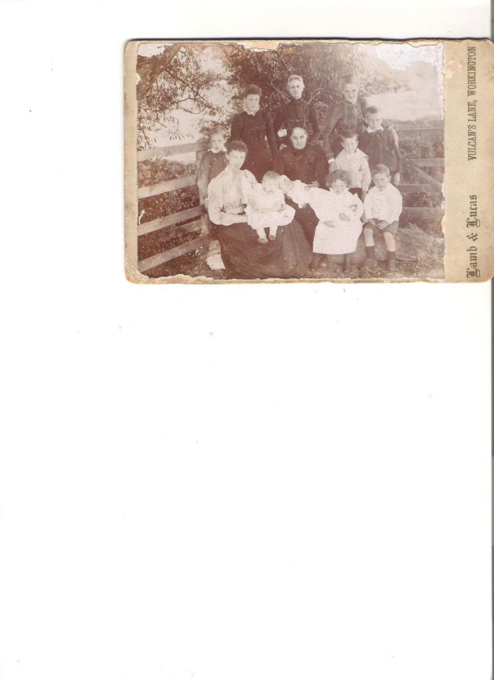 Family photo with Charles as a boy standing on the right with his younger brother Thomas